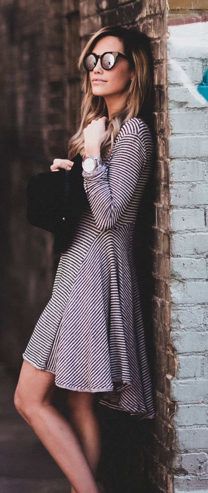 Striped Outfit Ideas: Megan Anderson is wearing a long sleeved pinstripe Urban Outfitters dress