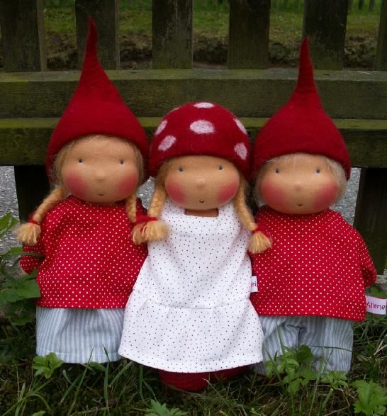 little felted gnomes ... jumping through the magic woodland. We love the little felted mushroom hats.