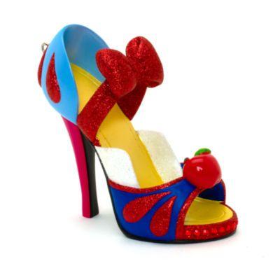 Cette mini chaussure Blanche Neige décorative et brillante est un cadeau idéal. Notre collection de chaussures décoratives capture l'esprit magique de Disney dans chacun de ses modèles à l'effigie d'un personnage.
