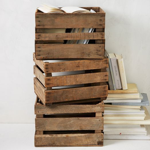 Once used in apple orchards, these rustic wooden crates make excellent organizers for records, books and knickknacks. Stack a few or mount on the wall for makeshift shelving.
