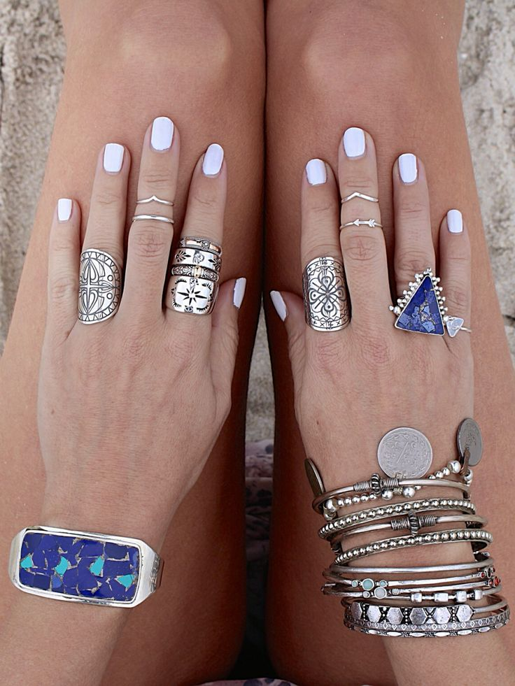Silver accessories and white nails