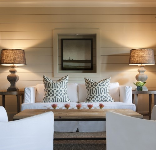 Horizontal VJ panelling, white slipcovered furniture and timber and burlap lamps.
