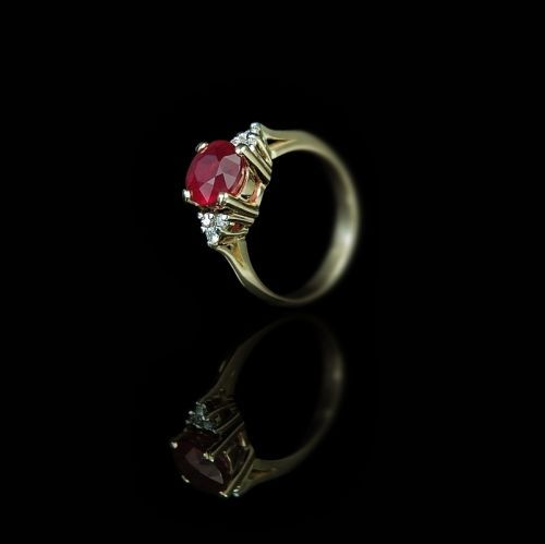 3 ct pigeon blood ruby with diamonds in a classic yellow gold setting.