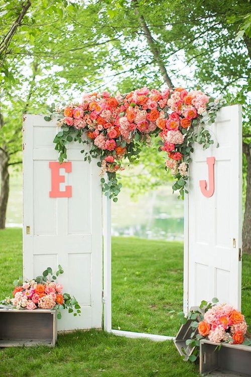 Our freestanding wooden doors help create this gorgeous and personalized alter for Joe and Emily's outdoor wedding! Gorgeous florals by Amanda Veronee of Anthomanic. *Paisley & Jade vintage & Eclectic Furniture Rentals for Events, Weddings, Theatrical Productions & Photo Shoots*