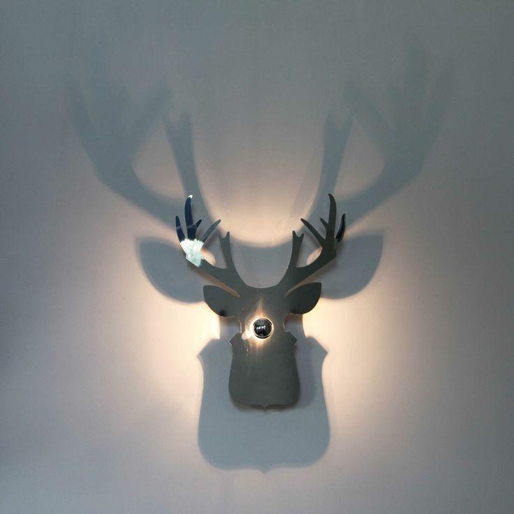 Luminaire troph e de chasse ombre port e sur le mur - Les appliques luminaires ...