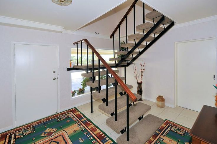 Entry and stair way of 4 bedroom 1970s house law street