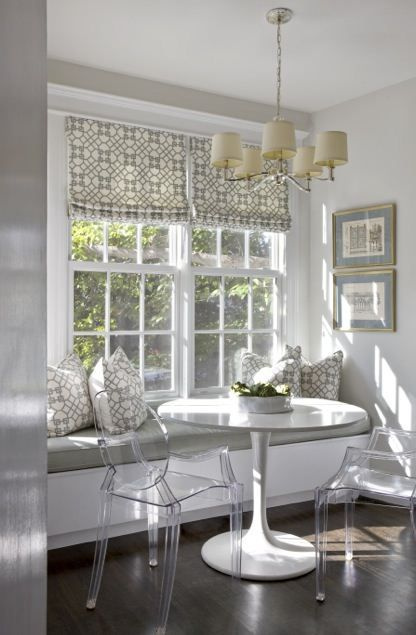 Breakfast table   Gray breakfast nook, white trim, lucite chairs, built in bench