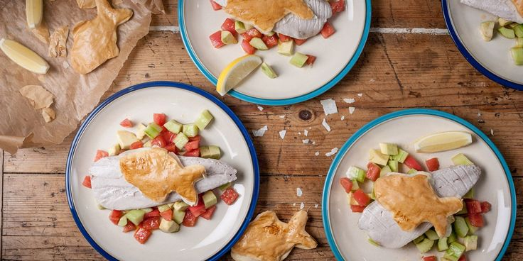 A vibrant baked mackerel recipe is made even livelier by a fresh salsa recipe which includes tomato, cucumber, and avocado
