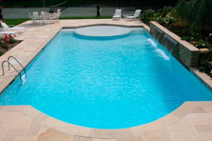 Pool shape but with travertine pavers (not bluestone) and minus the water feature.