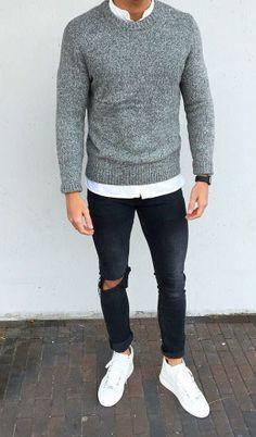 Very modern casual style for men with white sneakers, black jeans and gray pullover. Perfect outfit for the fall and winter.