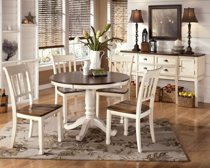 Dark Brown Wooden Round Dining Table Set With White Carved Pedestal Base Combined By White Chairs With Brown Seater On Grey Areas Rug