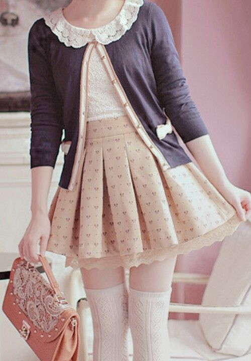 There's so many little bits to this that I love; like the lacy collar and heart-print on the pleated skirt.