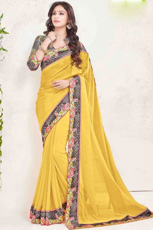 Yellow Georgette Saree with art silk blouse online\    http://www.andaazfashion.co.uk/womens/sarees