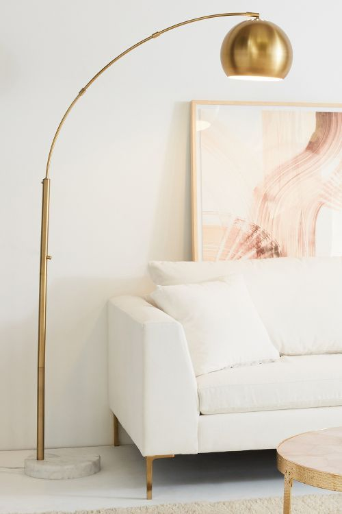 white gold and blush love the modern white sofa mixed with the arched gold floor lamp so