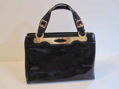 Shop my closet on @Jodie Guirey. I'm selling my Holt Renfrew Bag. Only $187.00
