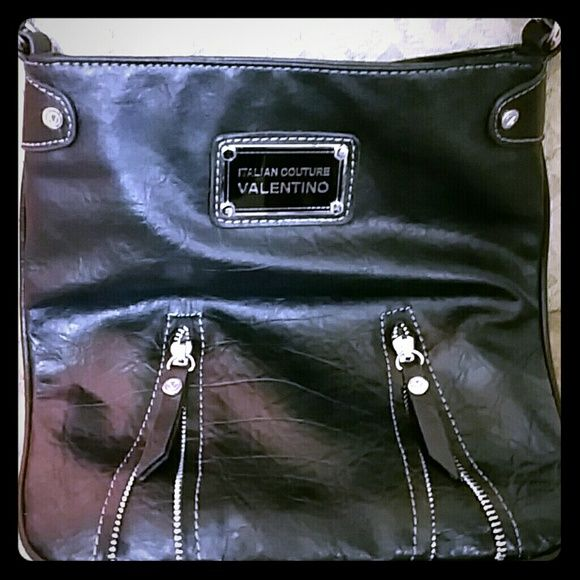 Valentino crossbody purse Black Valentino crossbody with no flaws whatsoever,  Valentino lining and label inside the bag. Stylish and chic, with two zipper accents on the front. Valentino Bags Crossbody Bags