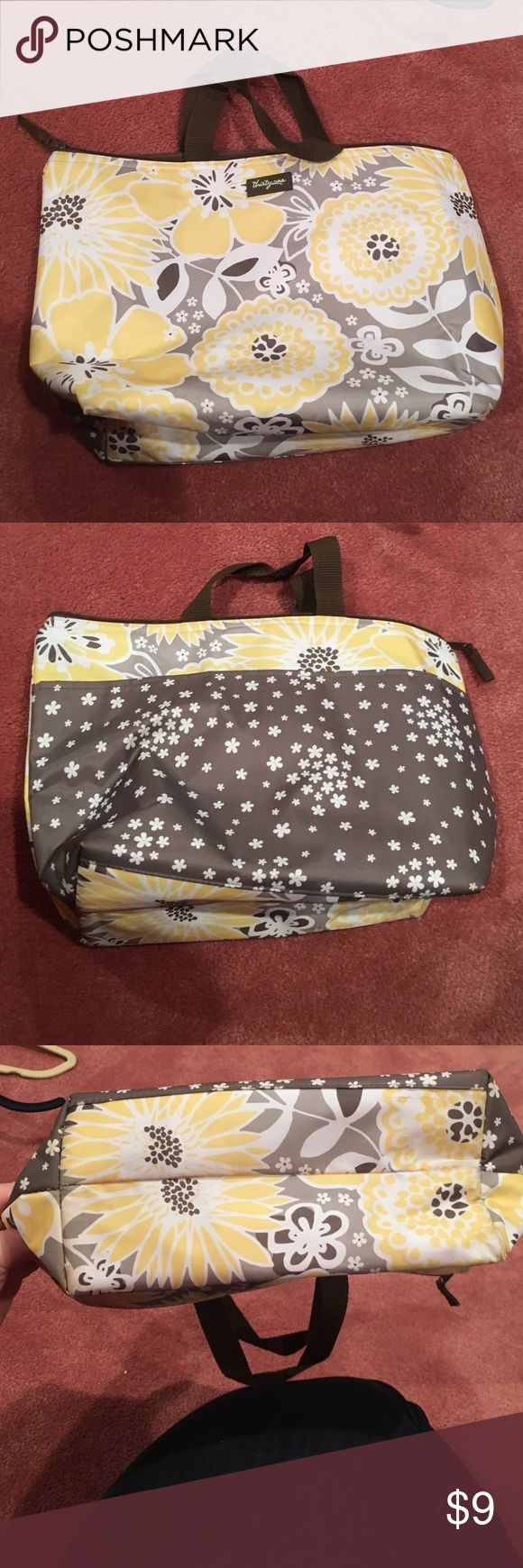 Thirty-one yellow and gray floral print lunch bag Thirty-one gray and floral print lunch bag.  Bag is in great overall condition and shows very slight wear on the bottom.  It was only used a few times.  Comes from a smoke free and pet free home.  Bundle and save! Thirty-one Bags