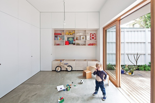 opposite the new kitchen, a rumpus room and play area doubles as a study at night - versatility in main living spaces
