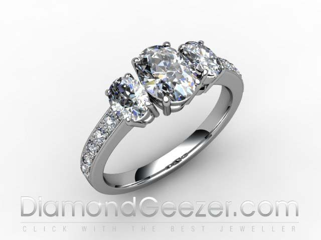 Oval Diamond Trilogy Ring with Diamond Shoulders in Hallmarked Platinum.