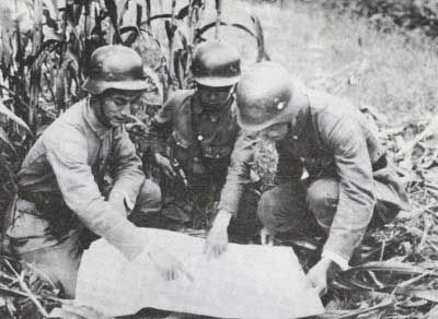 Officers of the Chinese 88th Division studying a map ...