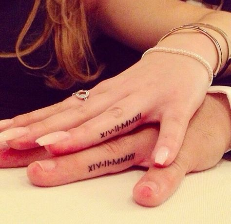 Cool ink.... More Tattoo Couple, Idea, Engagement Tattoo, Romans Numerals Tattoo, Couple Tattoo Fingers Romans, Fingers Tattoo, Wedding Date Tattoo, Tattoo Piercing, Matching Tattoo I like the idea of having a tattoo under the ring, so even when its taken off its there. 32 Real Couples Who Gave Up Their Engagement Rings For Tattoos: When Behati Prinsloo revealed her engagement tattoo — three small dots that run vertically down her ring finger — we were surprised. 7 Couples Who Expressed…
