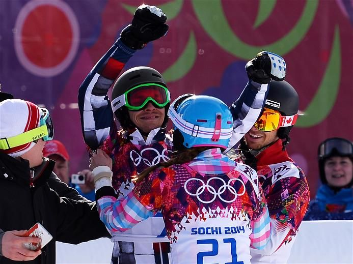 Vic Wild of Russia (C) celebrates winning the gold medal in the Snowboard Men's Parallel Giant Slalom Finals, with Alena Zavarzina of Russia, who won the bronze medal in the Snowboard Ladies' Parallel Giant Slalom Finals. Sochi 2014 Day 13 - Snowboard Ladies' Parallel Giant Slalom. © 2014 XXII Winter Olympic Games.