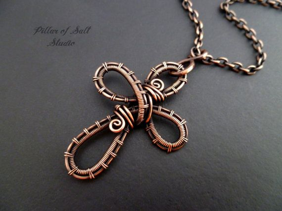 Handmade wire wrapped pendant.  This cross pendant is made by weaving and shaping solid copper wire. I then antique the copper and give the pendant a clear coat to help prevent further tarnishing. The cross measures approximately 1 1/2 long and about 1 1/8 across. Because each one is handmade there will be slight variations from the one in the photo, but yours will be very similar.  The pendant comes with a chain in the length of your choice (choose from the drop-down menu above). See the…