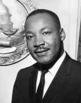 At 6:01 p.m. on April 4, 1968, civil rights leader Dr. Martin Luther King Jr. was hit by a sniper's bullet. King had been standing on the balcony in front of his room at the Lorraine Motel in Memphis, Tennessee, when, without warning, he was shot. The .30-caliber rifle bullet entered King's right cheek, traveled through his neck, and finally stopped at his shoulder blade. King was immediately taken to a nearby hospital but was pronounced dead at 7:05 p.m.