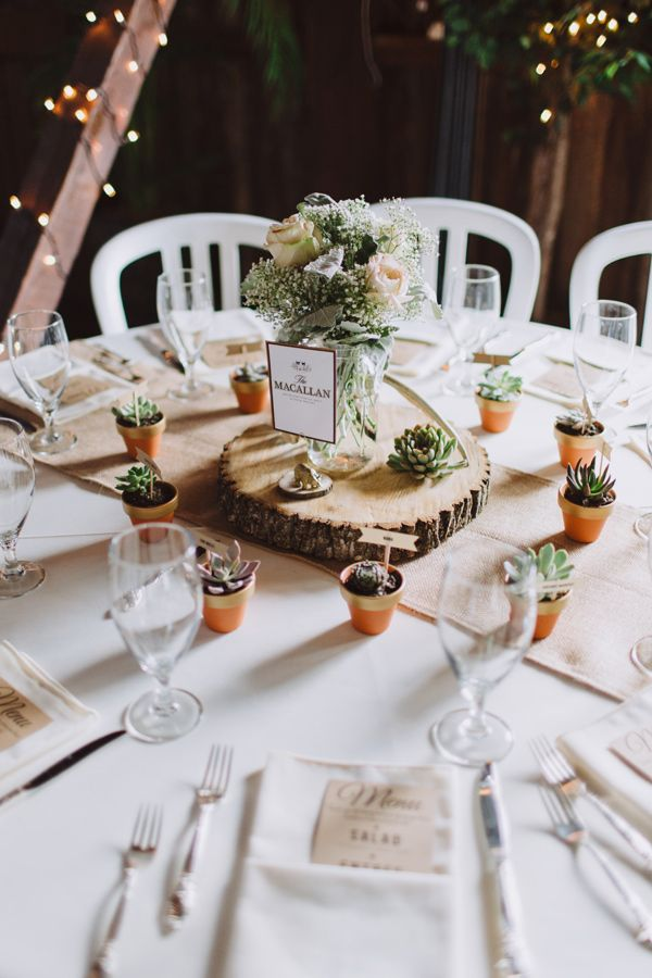 reception table with wood slice centerpiece, photo by With Love & Embers http://ruffledblog.com/ostertag-vistas-wedding #weddingideas #centerpieces #woodslices