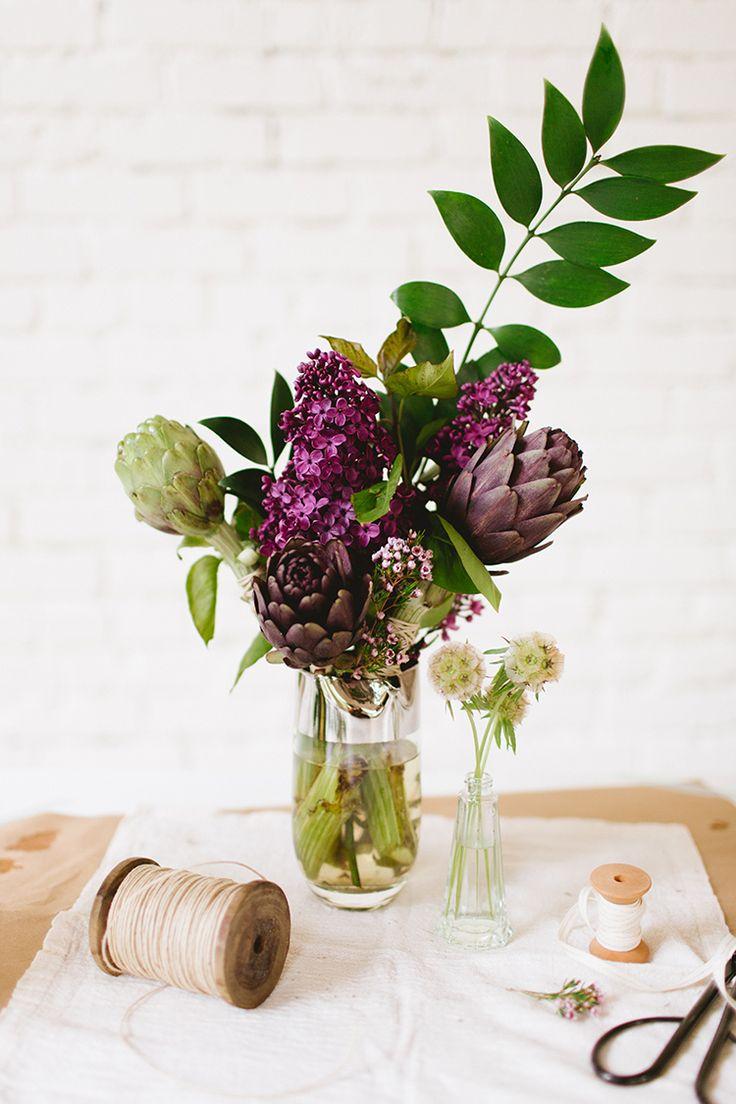 spring- fresh flower arrangement uses artichokes and lilacs www.jojotastic.com photography by @meghanklein