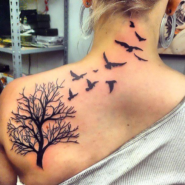 A nice tattoo idea with birds flying from a tree.