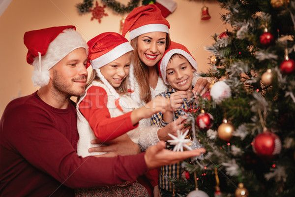 Family Decorating Christmas Tree Stock Photo C Milanmarkovic78 8540439 Stockfresh Christmas Tree Decorations Holiday Photography Christmas Tree
