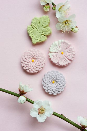 Japanese sweets and apricot flower ..... .you may present a set of Wagashi sweets ....