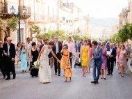 Sicilian wedding processional in Sambuca di Sicilia. Wedding dress by Claire Pettibone.