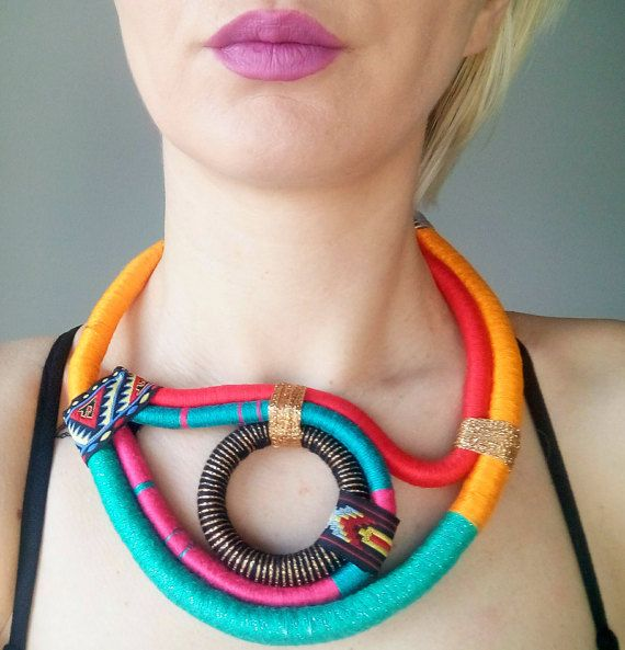 Fantastic colorful statement necklace made from cotton rope wrapped in different embroidery threads. This is a necklace made by myself, hand wrapped with love and dedication. African inspired necklace is about 40 cm and golden plated chain allows changes in length but if you want it longer or shorter, just let me know.