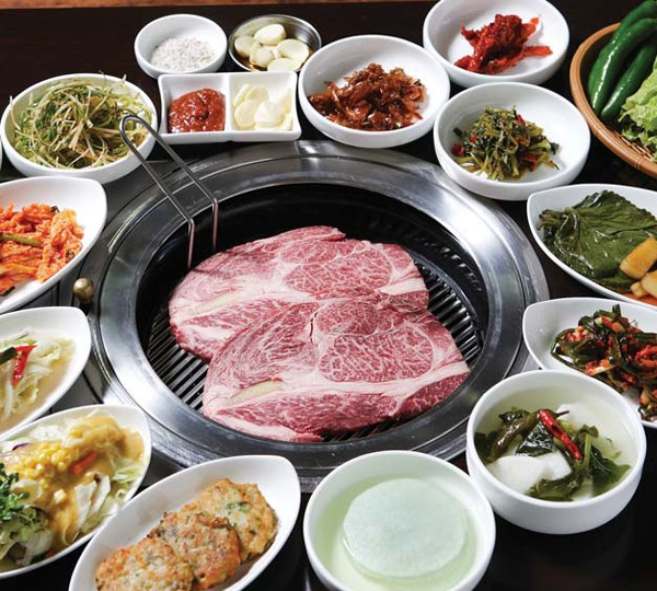 """Typical """"beef & leaf"""" restaurant in Korea. You grill your own meat at your table and have a variety of seasonings & veggies to serve it up with."""