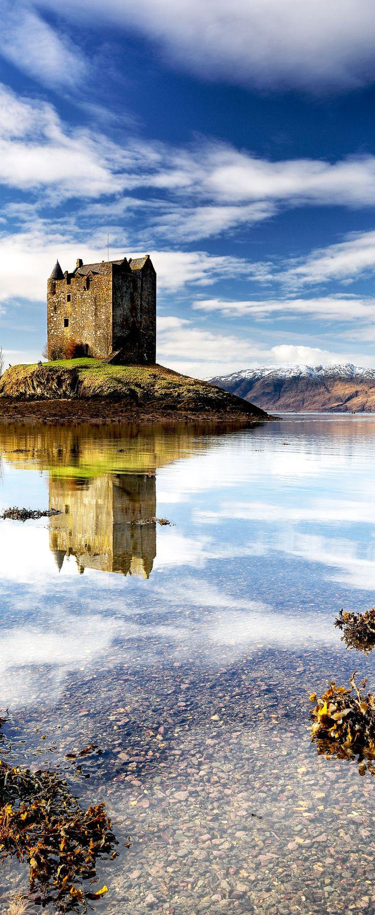 Beautiful Castle Stalker reflecting on Loch Linnhe in the west coast of Scotland