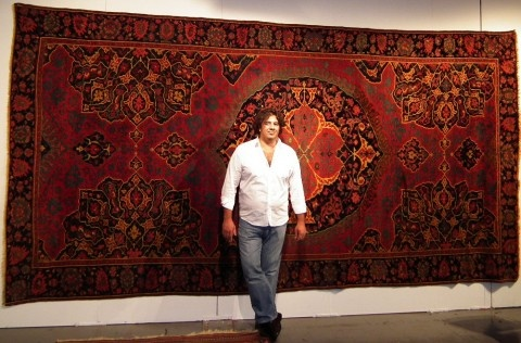 David Sorgato in front of the most exclusive carpet in this fair, a 17th century Ushak in good condition.