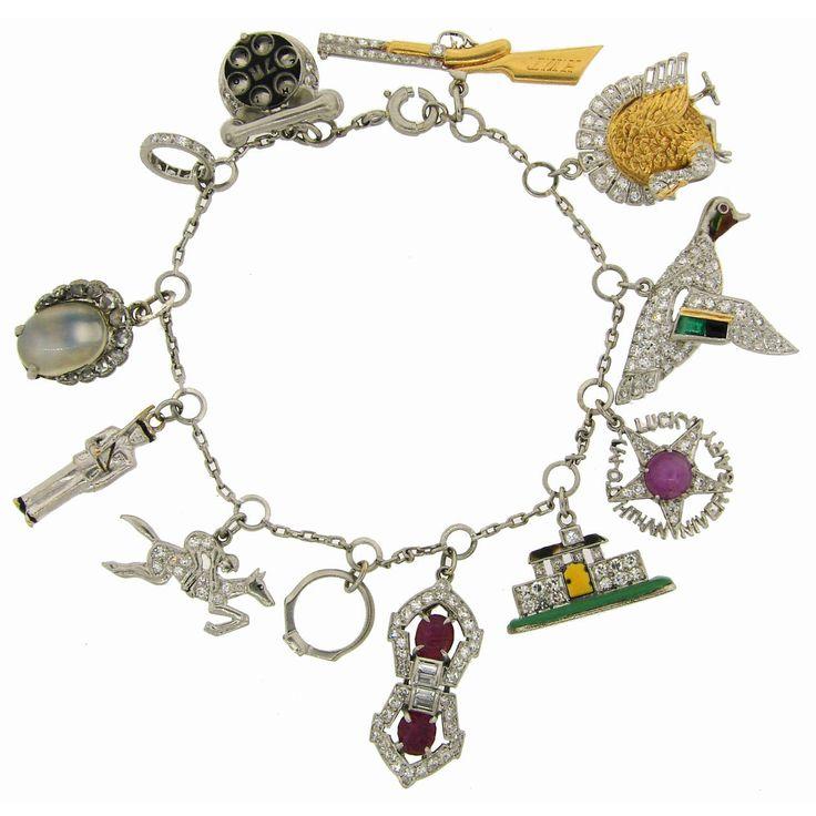 Art Deco c. 1920s Multi Gems Enamel Gold & Platinum Charm Bracelet | See more rare vintage Charm Bracelets at http://www.1stdibs.com/jewelry/bracelets/charm-bracelets