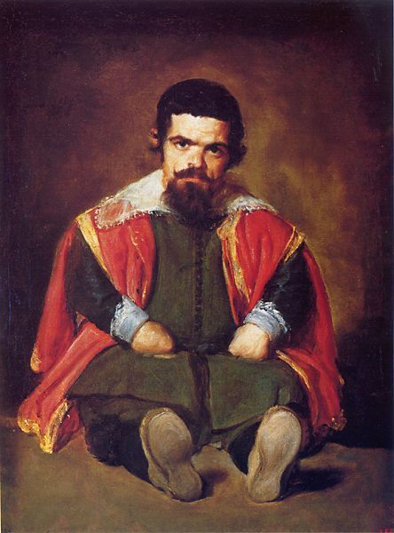 """""""Portrait of Sebastián de Morra"""" by Diego Velázquez. Sebastián looks blankly at the painter suggesting a denunciation of the court's treatment of himself and other dwarves."""