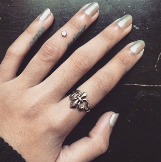 This perfectly-placed dermal is just as stunning as a ring! #InkedMagazine #dermal #bodmod #piercings #cool