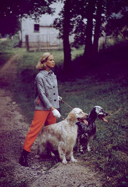 Walking the dog: Patsy Pulitzer wearing Fall fashions, 1954.