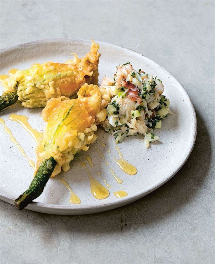 Goat's cheese stuffed courgette flowers with apple and coriander crab salad from Jason Atherton's Social Suppers. Find it on Cooked.com.