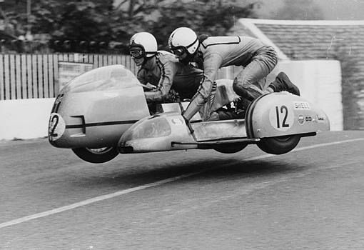 Sidecar TT race, Isle of Man, 1970. This motorcycle and sidecar combination are airborne as they cross Ballaugh Bridge on the TT circuit.