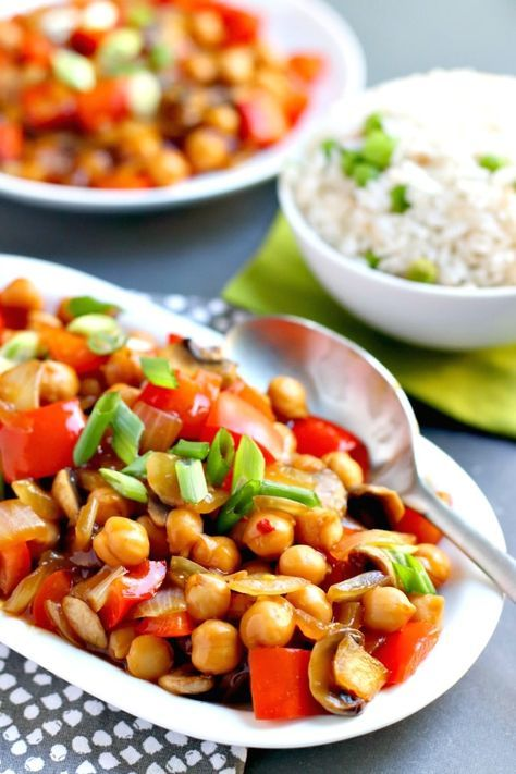 Chickpea Stir Fry made with garbanzo beans, red bell pepper, onion, and mushrooms in a savory sauce, served with steamed rice