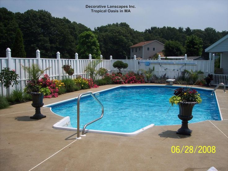 Pool landscaping tropical oasis by pool in ma colorful for Landscape design for pool areas