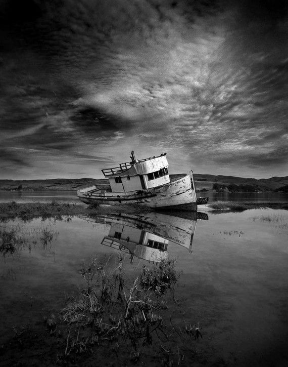 reflection photography tips. bw old wooden boat water clouds reflections solitude beauty landscape photography tipsphotography reflection tips