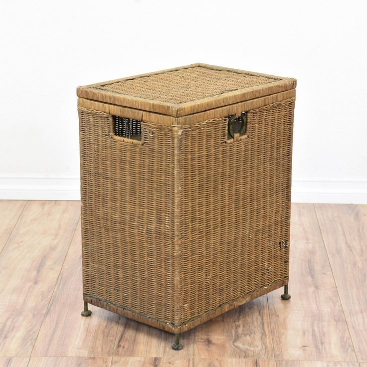 This tropical hamper is featured in a woven wicker rattan with a medium toned finish. This storage basket is in great condition with a lift up top, interior cabinet with fabric lining and metal legs. Beach chic storage piece perfect for storing linens! #tropical #storage #cabinet #sandiegovintage #vintagefurniture