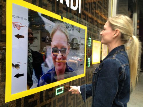 Bloomingdale's window displays allow you to try on sunglasses w/o entering the store