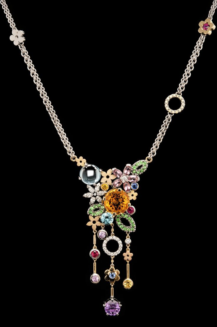 What a statement piece this gorgeous Flower necklace is. Made all in 18ct gold and set with precious stones.
